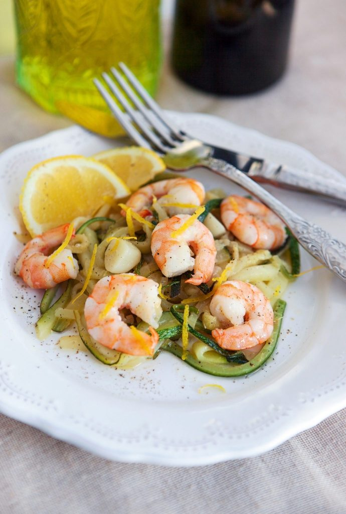 Lemon butter marinated shrimp served with zucchini noodles.