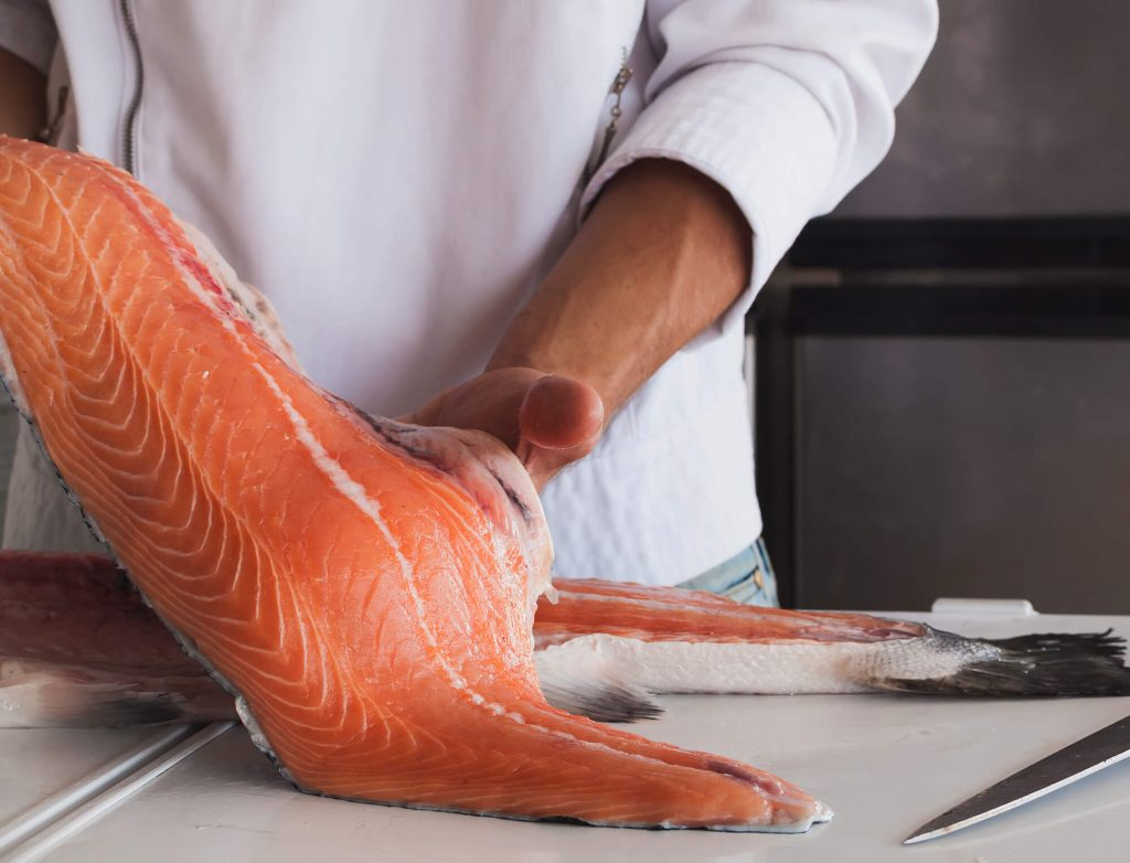 Types of Salmon - chef filleting